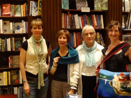The FictionKNITstas and host, each with their knitted pieces.